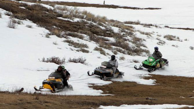 Law enforcement officials on snowmobiles traverse the mountains outside of Ferron in central Utah in this image made Tuesday, April 2, 2013, and provided by the Emery County Sheriff's Office. Dozens of officers acting on a Good Friday tip converged on the area using snowmobiles and a snowcat early Tuesday capturing Troy James Knapp, a survivalist suspected of burglarizing dozens of remote Utah cabins where he stayed while eluding capture for six years. (AP Photo/Emery County Sheriff's Office)