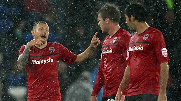 Cardiff City&#39;s Craig Bellamy (left) celebrates scoring his sides first goal of the game