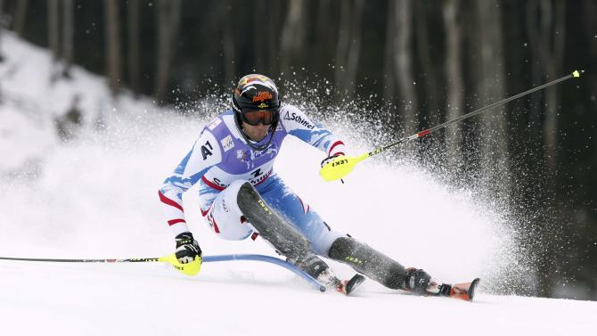 Austria's Mario Matt clears a gate during the first run of the men's slalom, at the Alpine skiing world championships in Schladming, Austria, Sunday, Feb.17, 2013. (AP Photo/Alessandro Trovati)