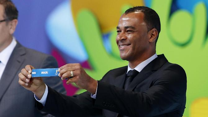 former soccer great and World Cup winner Cafu from Brazil holds the ticket of Brazil during the draw ceremony for the 2014 soccer World Cup in Costa do Sauipe near Salvador, Brazil, Friday, Dec. 6, 2013