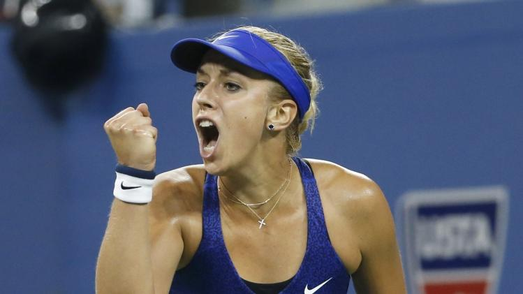 Sabine Lisicki of Germany reacts after winning a point against Maria Sharapova of Russia in their women's singles match at the 2014 U.S. Open tennis tournament in New York