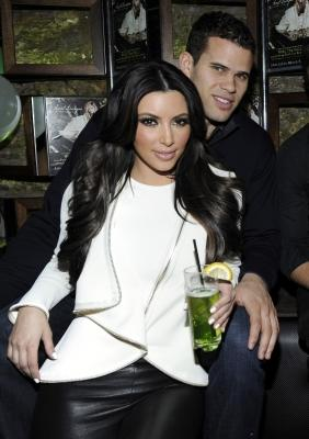 """Kim Kardashian and Kris Humphries cuddle up at the Onitsuka Tiger And RCA Records Present The Release Of Avril Lavigne's """"Goodbye Lullaby"""" at SL in New York City on March 8, 2011  -- WireImage"""