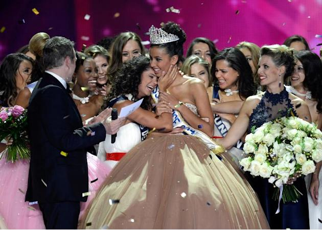 Miss Orleans Flora Coquerel (C) is congratulated after being crowned Miss France 2014 during the 67th edition of the beauty contest in the northeastern city of Dijon on December 7, 2013