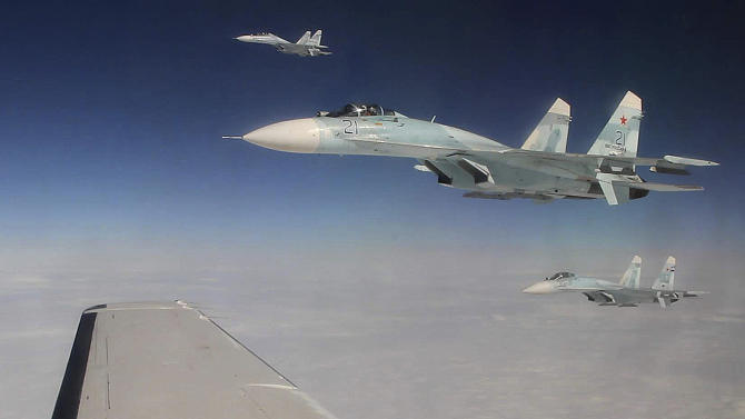 This photo made Tuesday, Aug. 27, 2013, over the Bering Strait near Alaska shows three Russian Federation Air Force SU-27s intercepting a passenger plane that was hijacked during a simulation to test the response of NORAD and Russian Federation forces. The exercise among Canadian and U.S. forces from NORAD, along with the Russian Federation, saw the Canadians successfully hand off the hijacked plane to Russian fighters over the Bering Strait. (AP Photo/Mark Thiessen)