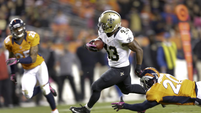 New Orleans Saints running back Darren Sproles (43) runs for a touchdown past Denver Broncos strong safety Mike Adams (20) and cornerback Champ Bailey (24) in the second quarter of an NFL football game, Sunday, Oct. 28, 2012, in Denver. (AP Photo/Jack Dempsey)