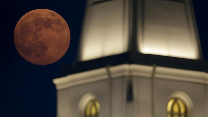 A full moon rises beyond a Latter-day Saints temple Saturday, June 22, 2013, in Kansas City, Mo. The moon, which will reach its full stage on Sunday, is expected to be 13.5 percent closer to earth during a phenomenon known as supermoon. (AP Photo/Charlie Riedel)