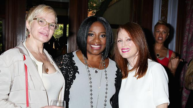 "This May 27, 2014 photo released by Starpix shows actors Ellen Barkin, left, LaTanya Richardson Jackson, center, and Julianne Moore, at an afternoon tea hosted by Moore and honoring Jackson for her 2014 Tony Award nomination for best actress in a play for her role in ""A Raisin in the Sun,"" at Lady Mendl's Tea Salon in New York. (AP Photo/Starpix, Dave Allocca)"