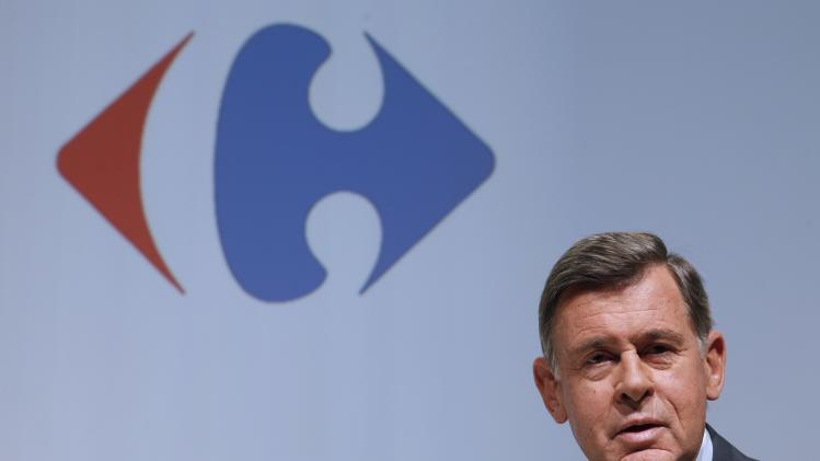 Carrefour Chief Executive Plassat poses before the company's 2014 first-half results presentation in Paris