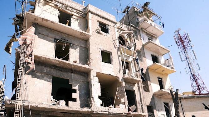 "This photo released by the Syrian official news agency SANA shows a damaged building after a blast in Aleppo, Syria, Sunday, March 18, 2012. An explosion ripped through a residential neighborhood in the northern Syrian city of Aleppo on Sunday and the state news agency said it was a ""terrorist bombing."" The report by SANA gave no information on casualties in what appeared to be the second attack in two days on cities where President Bashar Assad's regime enjoys strong support. (AP Photo/SANA)"