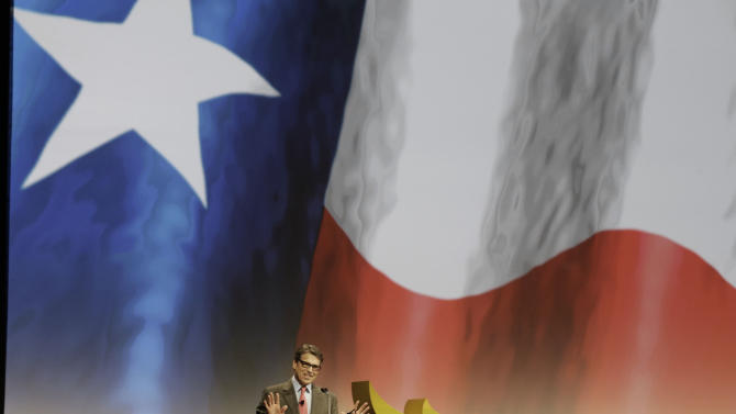 Texas Gov. Rick Perry speaks at the Americans for Prosperity gathering Friday, Aug. 29, 2014, in Dallas. Perry and Kentucky Sen. Rand Paul are bashing what they call the president's lack of leadership in response to the violent militant group attacking cities in Iraq. Both are among four top Republicans considering 2016 White House bids addressing the conservative summit in Dallas. (AP Photo/LM Otero)
