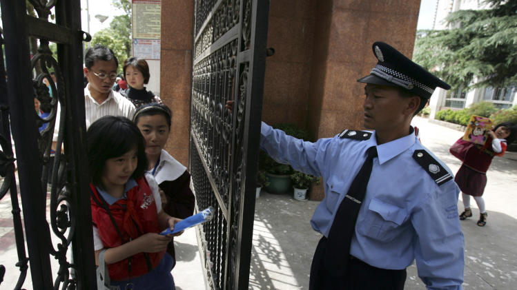 Pupils enter a primary school in Kunming