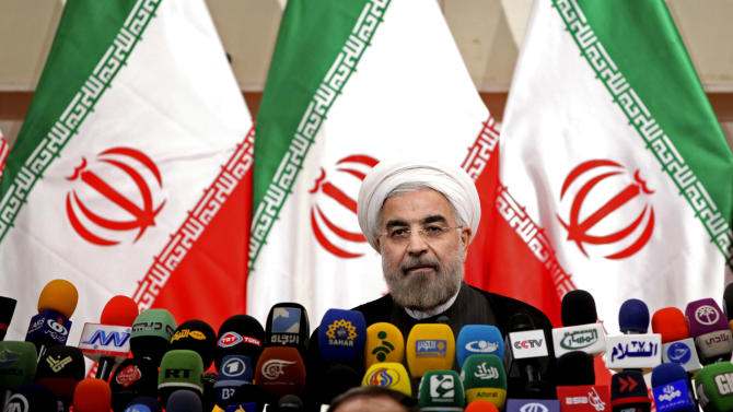 """Iranian newly elected President Hasan Rowhani, listens during a press conference, in Tehran, Iran, Monday, June 17, 2013. Rowhani showcases his reformist image by promising a """"path of moderation,"""" the easing of nuclear tensions and steps to narrow the huge divide with the United States. He also make clear where he won't go, saying he opposes any halt to uranium enrichment, at the heart of the nuclear standoff. (AP Photo/Ebrahim Noroozi)"""