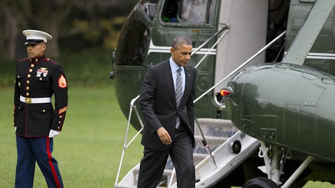 President Barack Obama walks from the Marine One helicopter on the South Lawn of the White House in Washington, Tuesday, Nov. 5, 2013, to the Oval Office after a trip to Walter Reed National Military Medical Center to visit with wounded troops. (AP Photo/ Evan Vucci)