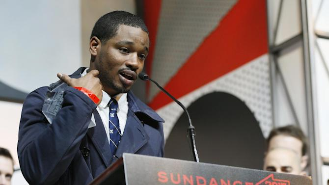 """Director and screenwriter Ryan Coogler accepts the  U.S. Grand Jury Prize: Dramatic for """"Fruitvale"""" during the 2013 Sundance Film Festival Awards Ceremony on Saturday, Jan. 26, 2013 in Park City, Utah. (Photo by Danny Moloshok/Invision/AP)"""