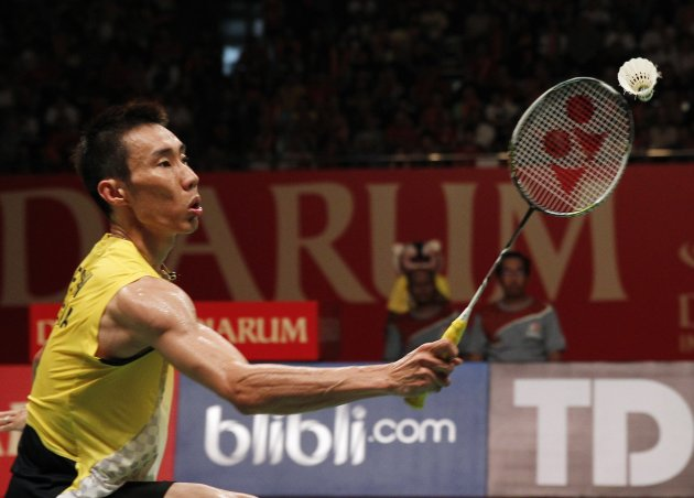 Malaysia's Lee competes against Germany's Zwiebler at the Djarum Indonesia Open 2013 badminton tournament in Jakarta