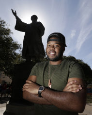 In this March 5, 2013 photo, University of Texas senior Bradley Poole poses for a photo on campus near the Martin Luther King Jr. statue in Austin, Texas. Poole, an advertising major, became president of the school's Black Student Alliance, seeking camaraderie after noticing he often was the only African-American in his classes. In two pivotal legal cases, one on affirmative action and another on voting rights, a divided U.S. Supreme Court may be poised in the coming weeks to rule that racism is largely a relic of America's past. The question is apt as the nation nears a demographic tipping point, when non-whites become the country's majority for the first time. (AP Photo/Eric Gay)