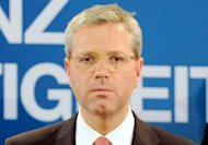 Norbert Roettgen, top candidate of German Christian Democrats Party (CDU) in North Rhine-Westphalia speaks after the publication of first results of the regional elections in the party&#39;s headquarter after in Duesseldorf. Voters in a crucial German state emphatically punished Chancellor Angela Merkel&#39;s pro-austerity party Sunday, awarding her main centre-left rivals a major boost