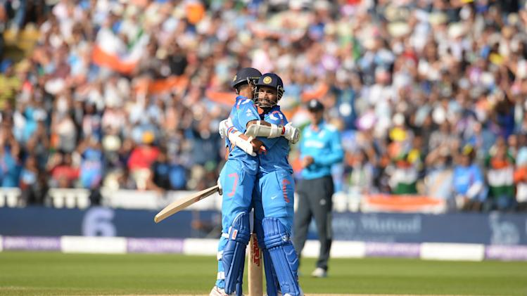 India's Rahane and teammate Dhawan embrace after Rahane reached his half century during the fourth ODI cricket match against England in Birmingham