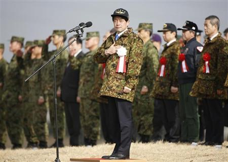 Japan's Defence Minister Onodera reviews troops from the Japanese Ground Self-Defense Force 1st Airborne Brigade during an annual new year...