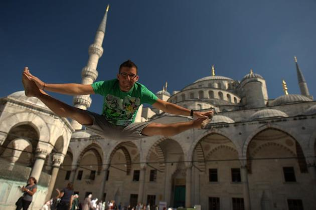 Traveler Takes Incredible Toe-Touch Pictures Around the World
