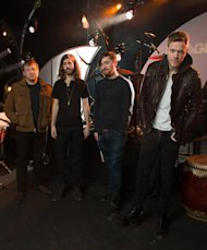 In this Feb. 6, 2013 photo, Las Vegas-based rock band Imagine Dragons, from left, Ben McKee, Wayne Sermon, Dan Platzman and Dan Reynolds pose for a group portrait in Las Vegas. The band&#39;s debut album Night Visions, has reached gold status and features the hits Its Time and Radioactive. The foursome, signed to music producer Alex da Kids label imprint, is currently on a U.S. tour. (Photo by Al Powers/ Powers Imagery/Invision/AP)