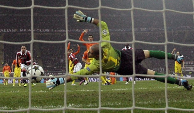 AC Milan's Kevin-Prince Boateng scores as Barcelona's goalkeeper Victor Valdes fails to save during their Champions League soccer match in Milan