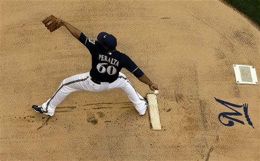 Peralta, Segura lead Brewers past Braves 2-0