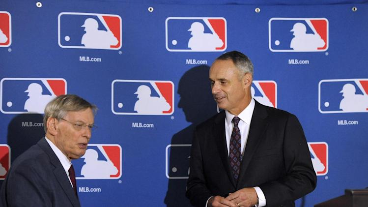 """Major League Baseball Commissioner Allan H. """"Bud"""" Selig, left, and Major League Baseball Chief Operating Officer Rob Manfred attend a news conference after team owners elected Manfred as the next commissioner of Major League Baseball during a quarterly owners meeting in Baltimore Thursday, August 14, 2014. (AP Photo/Steve Ruark)"""