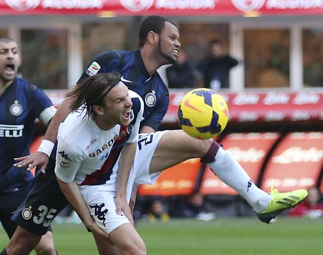 Cagliari midfielder Albin Ekdal, foreground, of Sweden, challenges for the ball with Inter Milan defender Jorge Rolando, of Portugal, during the Serie A soccer match between Inter Milan and Cagliari a