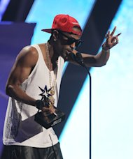 Big Sean accepts the award for best new artist at the BET Awards on Sunday, July 1, 2012, in Los Angeles. (Photo by Matt Sayles/Invision/AP)