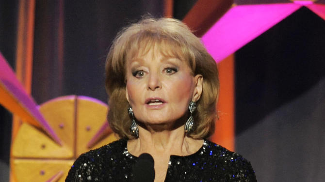 """FILE - This June 23, 2012 file photo shows Barbara Walters presenting an award onstage at the 39th Annual Daytime Emmy Awards in Beverly Hills, Calif. Walters says she's returning to """"The View"""" on Monday, March 4, 2013. Walters was hospitalized on Jan. 19 after fainting and cutting her head at a party in Washington. The 83-year-old said she had chickenpox and a fever at the time but didn't realize it.  (Photo by Chris Pizzello/Invision/AP, file)"""