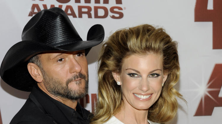 """FILE - This Nov. 9, 2011 file photo shows country singers Tim McGraw, left, and his wife Faith Hill at the 45th Annual CMA Awards in Nashville, Tenn. McGraw and Hill are brushing off divorce rumors as they power into a new round of """"Soul2Soul"""" duet performances in Las Vegas. The country music royals sat close and joked with each other about tabloid headlines during a round table interview with reporters before their Friday Nov. 15, 2013, show at the Venetian casino. (AP Photo/Evan Agostini, file)"""