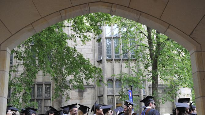 ADVANCE FOR SUNDAY MARCH 3 -  FILE - In this Monday, May 24, 2010 file photo, future graduates wait for the procession to begin for commencement at Yale University in New Haven, Conn. U.S. universities have responded to exploding demand in China for American higher education with branch campuses and aggressive recruiting. Now, some are trying to boost their brands by casting campus photos into the confounding sea of Chinese social media. (AP Photo/Jessica Hill)