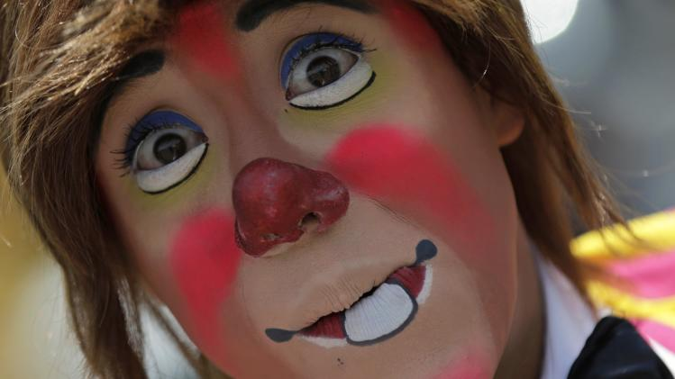 A clown is seen during a protest against a law prohibiting the use of animals in circuses, in downtown Mexico City