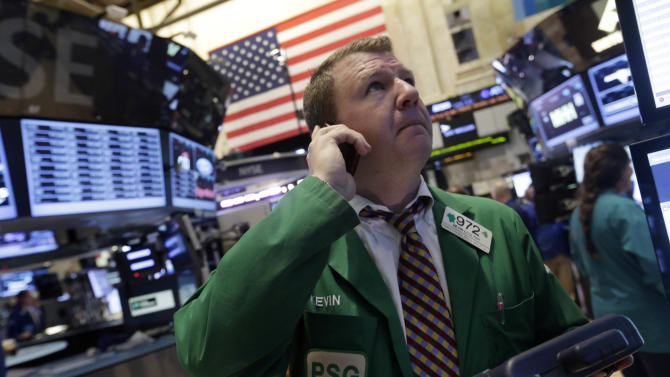 Trader Kevin Colter works on the floor of the New York Stock Exchange, Monday, June 10, 2013. The stock market is getting off to a mixed start as traders show only mild enthusiasm for an improving outlook for the U.S. government's credit rating. (AP Photo/Richard Drew)