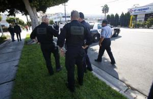 Officers are pictured in the vicinity of the apartment complex of suspect Nna Alpha Onuoha in Inglewood