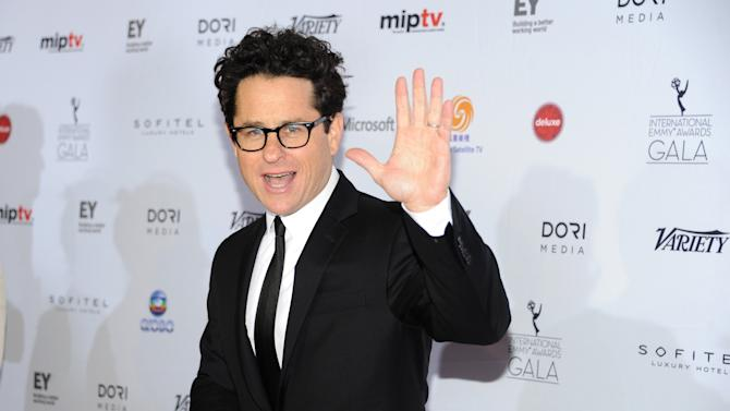 """In this Nov. 25, 2013 file photo, r=the """"Founders Award"""" recipient producer and director J.J. Abrams arrives at the 2013 International Emmy Awards Gala at the New York Hilton, in New York. From the set of """"Star Wars: Episode VII"""" in Abu Dhabi, the director Abrams announced the launch of Star Wars: Force for Change, a campaign to raise funds for United Nations Children's Fund's (UNICEF). The campaign will run from 12:01 a.m. PDT on May 21, 2014, until 11:59 p.m. PDT on July 18. (Photo by Evan Agostini/InvisionAP, file)"""