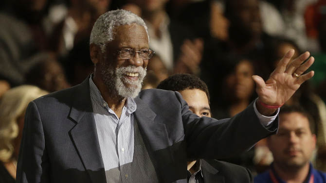 Former NBA player Bill Russell waves to the crowd during the NBA All Star basketball game, Sunday, Feb. 16, 2014, in New Orleans
