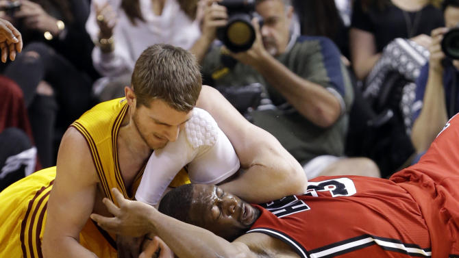 FILE - In this Feb. 24, 2013, file photo, Cleveland Cavaliers center Tyler Zeller, left, and Miami Heat guard Dwyane Wade battle for a loose ball during the first half of an NBA basketball game in Miami. The Heat won 109-105. Winners of 20 games in a row, the Heat could be headed toward history. The Cavaliers, who host the Heat on April 15, are one team looking for their opportunity to stop the streak. (AP Photo/Wilfredo Lee, File)