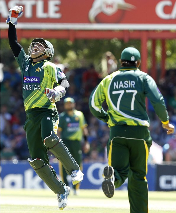 Pakistan's wicket keeper Akmal makes a catch to dismiss South Africa's Smith during their One day International cricket match in Bloemfontein