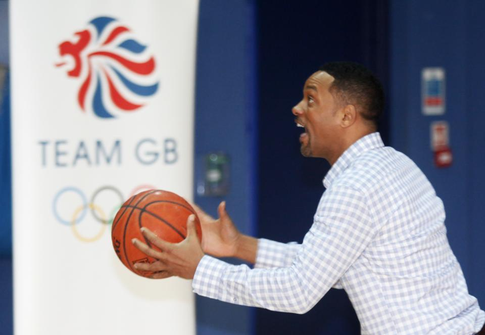 Actor Will Smith goes for layup against  Great Britain Olympic team basketball captain Drew Sullivan at Ethos gym in London, Wednesday, May 16, 2012. (AP Photo/Jim Ross)