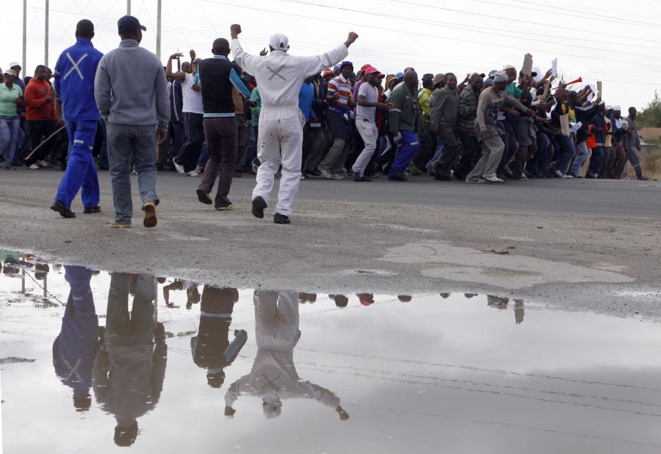 South Africa police halt peaceful strikers' march