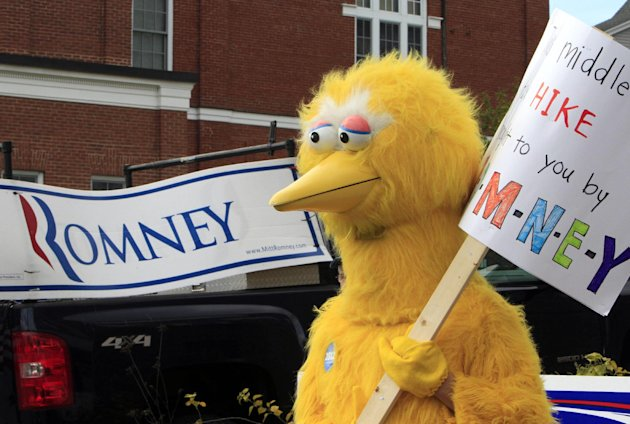A person dressed as Big Bird holds a sign outside Republican presidential candidate, former Massachusetts Gov. Mitt Romney&#39;s headquarters, Monday, Oct. 8, 2012 in Derry, N.H. where House Speaker John Boehner of Ohio was about to speak to supporters. (AP Photo/Jim Cole)