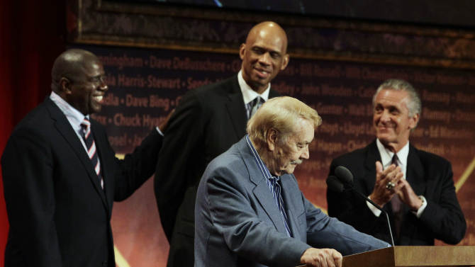 FILE - In this Aug. 13, 2010 file photo, Basketball Hall of Fame inductee, Los Angeles Lakers owner Jerry Buss, foreground, speaks as, from background left to right, Magic Johnson, Kareem Abdul Jabbar and Pat Riley react during the enshrinement ceremony in Springfield, Mass. Buss, the Lakers' playboy owner who shepherded the NBA franchise to 10 championships, has died. He was 80. Bob Steiner, an assistant to Buss, confirmed Monday, Feb. 18, 2013  that Buss had died in Los Angeles. Further details were not available. (AP Photo/Elise Amendola, File)