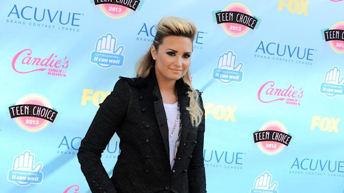 "FILE - In this Aug. 11, 2013 file photo, Demi Lovato arrives at the Teen Choice Awards at the Gibson Amphitheater, in Los Angeles. Lovato will appear on multiple episodes of the upcoming fifth season of ""Glee,"" her publicist confirms. (Photo by Jordan Strauss/Invision/AP, File)"