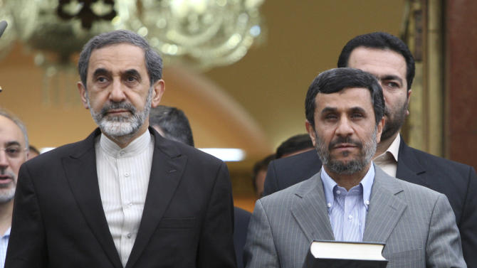In this photo taken on Monday, May 9, 2011, Iranian presidential hopeful, Ali Akbar Velayati, adviser to the Iranian supreme leader Ayatollah Ali Khamenei, left, stands next to President Mahmoud Ahmadinejad, prior to departure of Ahmadinejad to Turkey, at the Mehrabad airport, in Tehran, Iran. For eight years, Iran's President Mahmoud Ahmadinejad has played the role of global provocateur-in-chief: questioning the Holocaust, saying Israel should be erased from the map and painting U.N. resolutions as worthless. Now, a race is beginning to choose his successor -- candidate registration starts Tuesday for a June 14 vote -- and it looks like an anti-Ahmadinejad referendum is shaping up. (AP Photo/Vahid Salemi)