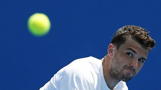 Grigor Dimitrov of Bulgaria hits a return to Julien Benneteau of France at the Australian Open (Reuters)