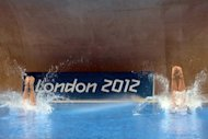 US divers Abigail Johnston and Kelci Bryant compete during the women&#39;s synchronised 3m springboard diving event at the London 2012 Olympic Games in London. China&#39;s diving diva Wu Minxia captured her third synchronised three-metre springboard Olympic gold medal with victory in the final with He Zi on Sunday