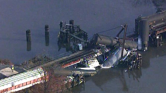 In this frame grab from video provided by WTXF Fox Philadelphia, crews work the scene where a freight train carrying hazardous chemicals derailed over Mantua Creek, Friday, Nov. 30, 2012, in Paulsboro, N.J. At least two tanker cars toppled into the creek causing a leak of hazardous vinyl chloride into the air Friday. Dozens of people went to a hospital complaining of breathing problems. (AP Photo/WTXF Fox Philadelphia)