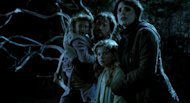 This film image released by Universal Pictures shows, from left, Isabelle Nlisse, Nikolaj Coster-Waldau, Megan Charpentier and Jessica Chastain in a scene from &quot;Mama.&quot; (AP Photo/Universal Pictures)